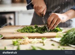 cooking chef cuisine cooking chef cutting greens kitchen stock photo 655762885
