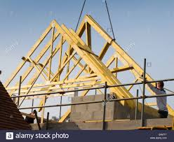 self building house constructing roof lifting roof trusses into