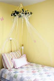 bedroom white metal kids bed with mosquito net and flower