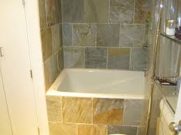 bathroom small soaking tub design with tile wall and tile floor