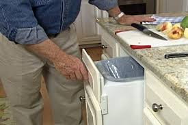 kitchen cabinet trash pull out how to make a pull out trash bin diy projects videos