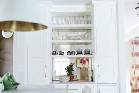 built in kitchen shelves with antiqued mirror backsplash