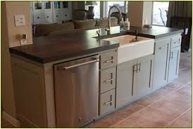 kitchen island with sink and raised bar