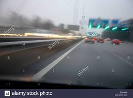 bad weather on the street road highway raining stock photo