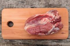 meat cutting table tops raw pork meat on cutting board on a table top view stock image