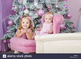 At Home Christmas Trees by Two Sisters At Home With Christmas Tree Portrait Of Happy