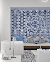 greek living room with built in bench seating love the blue wall