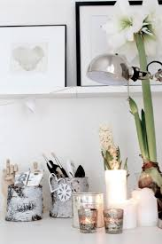 scandinavian home decor with modern desk lamp and white flower on