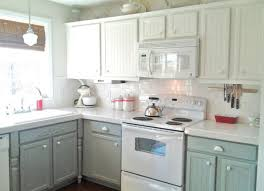 painting kitchen cabinets two different colors red oak wood cool mint windham door spray painting kitchen