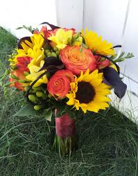 sunflowers circus rose yellow freesia green hypericum berries and