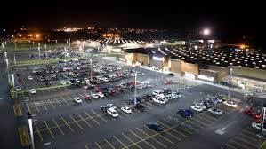 how many parking spaces can fit per acre reference com