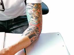 india ink tattoos in office the economic times