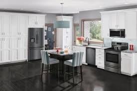 white kitchen cabinets and black stainless steel appliances frigidaire 25 5 cu ft side by side refrigerator 36 inch black stainless steel