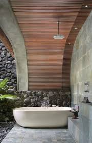 incredible outdoor bathroom ideas with neutral green plant and minimalist outdoor bathroom ideas with oval shape white bathtub and grey stone wall decoration