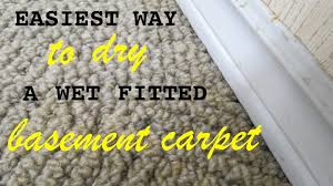 how to dry a wet fitted carpet in your basement with little