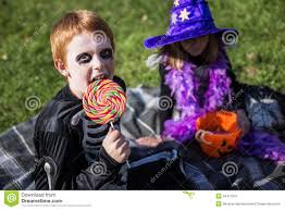 skeleton halloween costumes for girls boy and wearing halloween costume with candies skeleton