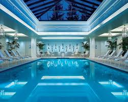 interior large indoor pool with white recessed lighting also