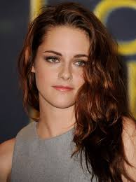 a side part with long hair and a swoop and a cross kristen stewart long hairstyle deep side part kristen stewart