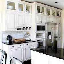 adding cabinets on top of existing cabinets look add a row of glass front cabinets over your existing cabinets