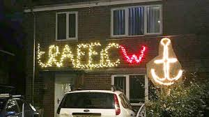 festive prankster uses lights to a cheeky dig at