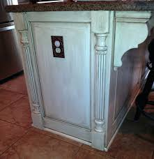 faux painting kitchen cabinets kitchen cabinets added panels and faux legs to the end of the