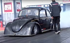 black volkswagen bug vw bug breaks 1 4 mile electric door car drag racing record