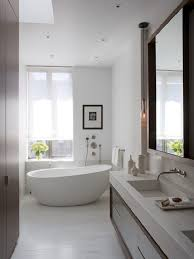 white bathroom ideas floor mount tub faucet curved wall mirror