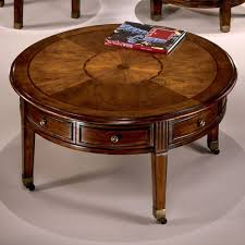 round coffee table with casters glen eagle round cocktail w casters signature design furniture cart