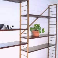 vintage 1960s ladderax wall mounted modular teak shelving system