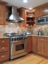 oak cabinets w granite counters and stone tile backsplash neutral