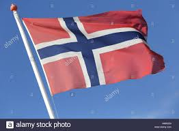 norwegian flag flying in the wind stock photo royalty free image