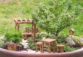 cute little square table closed sweet chair near mini bird stable