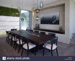 dark dining room dark wood dining table with assorted glass pendant lights in