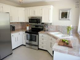 arresting paint a kitchen counter and painting kitchen cabinets