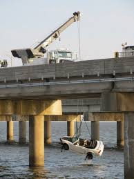 mobile bay mustang injured when car runs westbound bayway and falls into