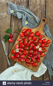 fruits flowers fresh strawberry fruits flowers leaves on white wood table stock