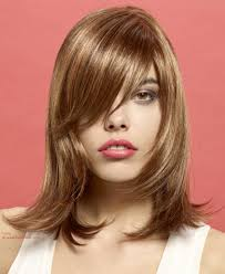 photos medium length flip hairstyles shoulder length hairstyle with layering tapering and an outward flip