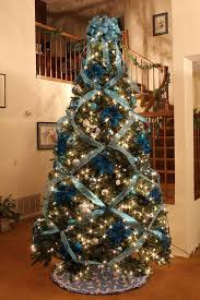 way to decorate a tree with ribbon professionally