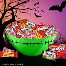 halloween bowl with grabbing hand skittles starburst life savers and hubba bubba gum halloween