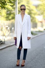le fashion blog new york street style eleonora carisi white coat ripped knee skinny jeans burgundy heels via popsugar png