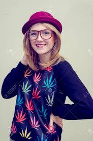 hipster girl studio portrait of teenage hipster girl wearing trendy eyeglasses