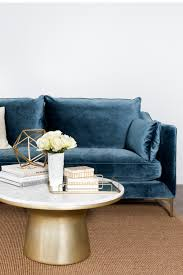 a blue sofa pop of color or glamorous statement piece blue door
