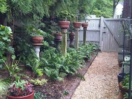 Landscape Design Ideas For Small Backyard by White Adirondack Chairs Simple Backyard Designs Wood Fence