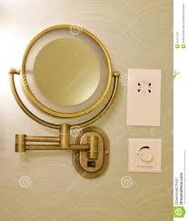 vintage look brass adjustable wall mount magnifying mirror on half