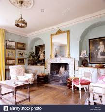 living room with fireplace and arched alcoves stock photo royalty