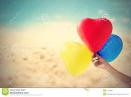 Beach Color by Vintage Color Tone Balloon Heart Shape In Hand On Sea Sand Beach
