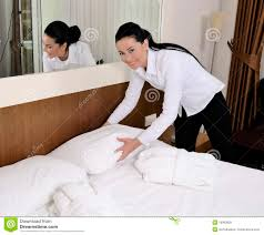 maid making bed in hotel room royalty free stock photos image
