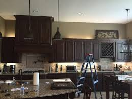 what color wood floors go with espresso cabinets tired of your kitchen s stale espresso colored cabinets do
