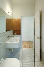 creative white concrete powder room trough sink with floating f