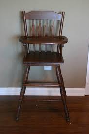 antique wooden highchair where the sidewalk ends
